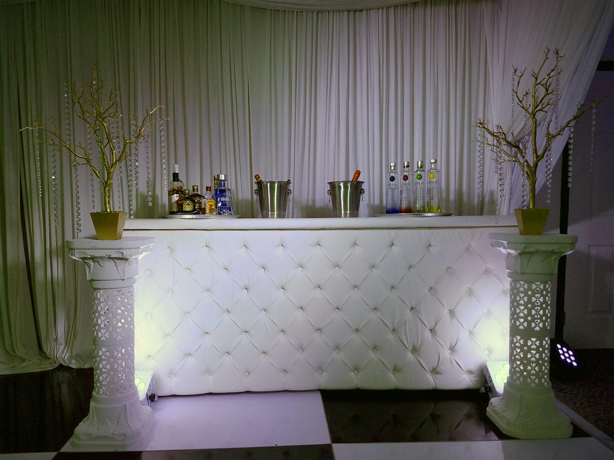 white tufted bar rentals